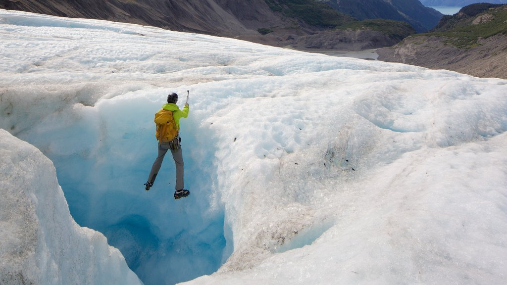 Godwin Glacier featuring climbing as well as an individual male