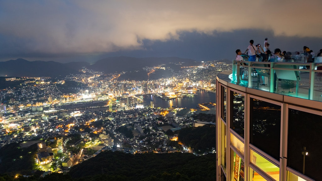 Kyushu and Okinawa which includes landscape views, a city and night scenes