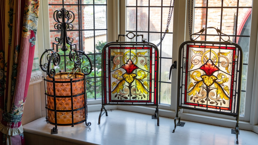 Yufuin Stained Glass Museum which includes interior views and heritage elements