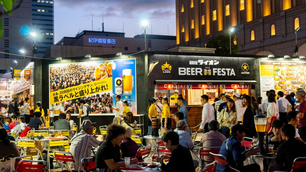 Sapporo showing outdoor eating and night scenes as well as a large group of people