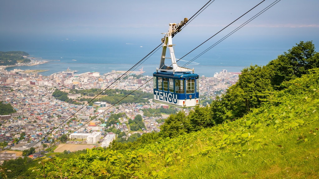 Otaru Tenguyama Ropeway which includes landscape views, a gondola and a coastal town
