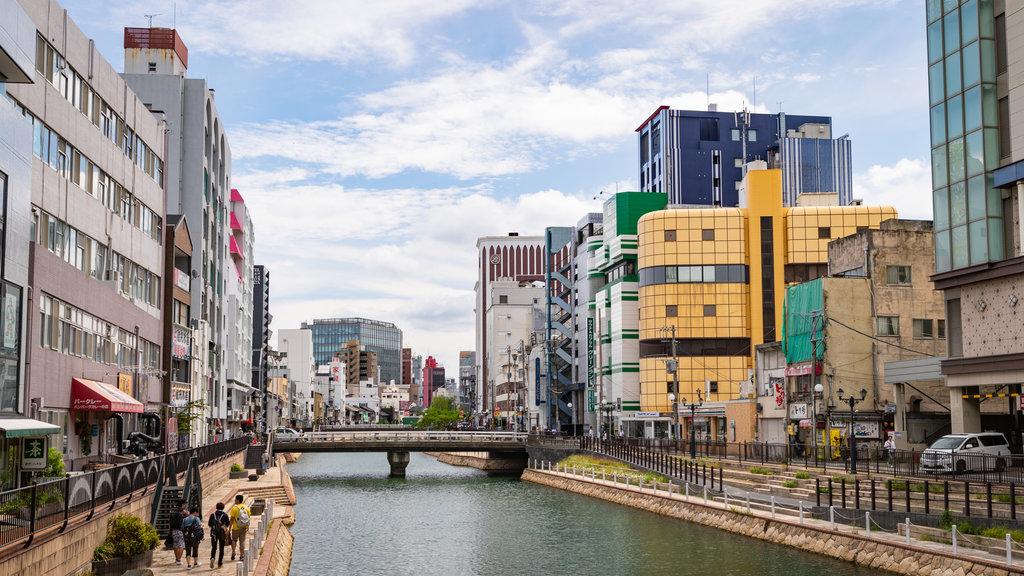 Hakata-ku showing a river or creek, a city and a bridge