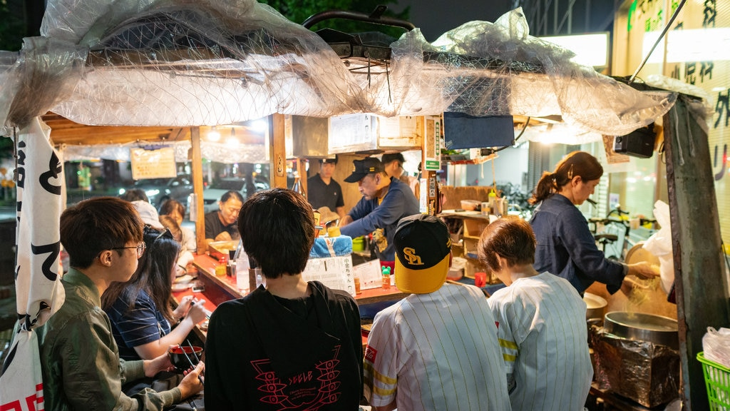 Tenjin which includes night scenes and markets as well as a small group of people