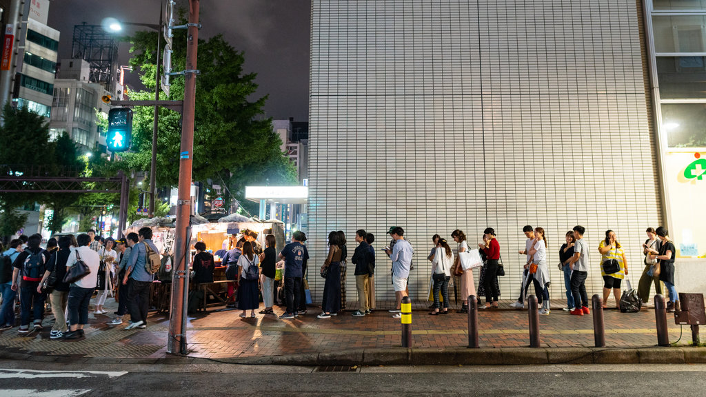 Tenjin which includes street scenes, a city and night scenes