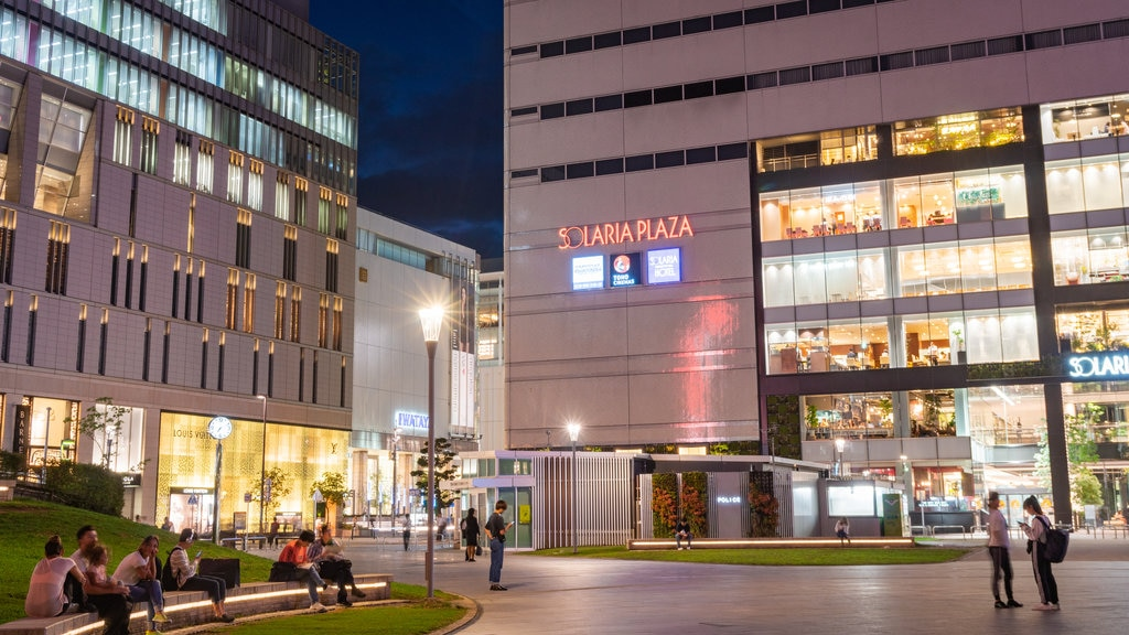 Tenjin featuring night scenes, street scenes and a city