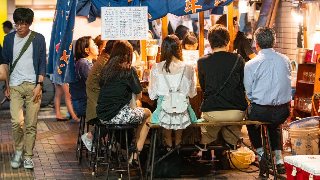 Tenjin showing street scenes, outdoor eating and night scenes
