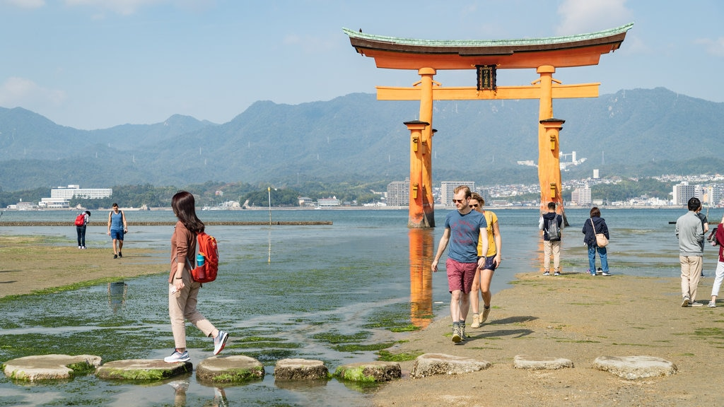 Itsukushima Shrine showing a river or creek, a beach and heritage elements