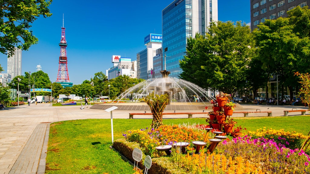 Odori Park featuring modern architecture, wildflowers and a fountain