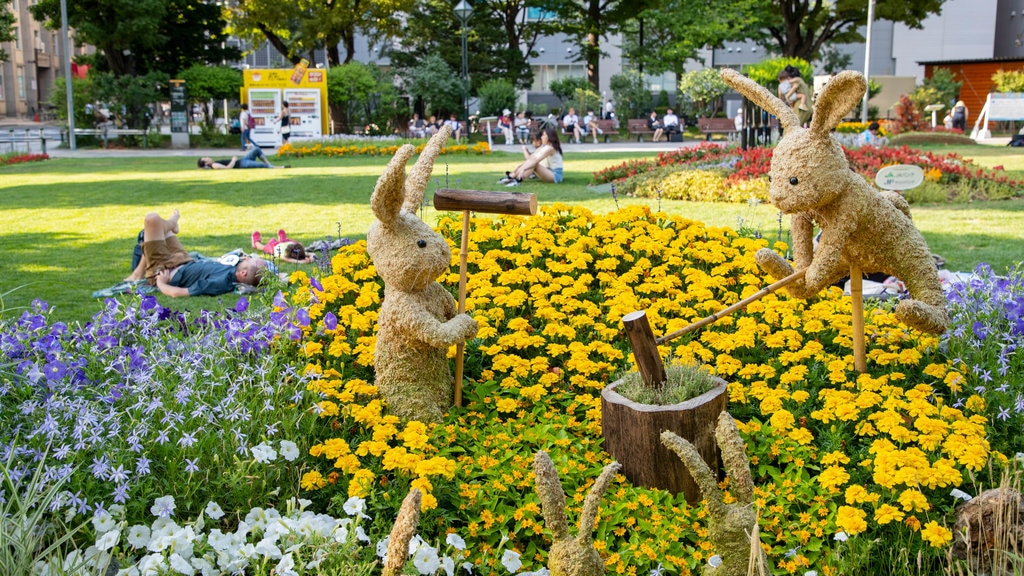 Odori Park which includes a garden, wildflowers and outdoor art