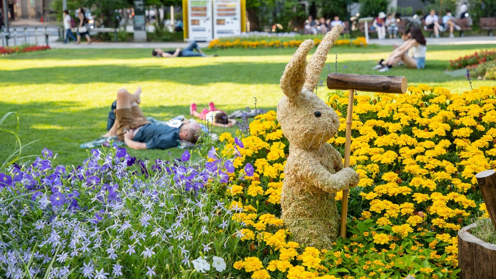 Odori Park showing flowers, wildflowers and outdoor art