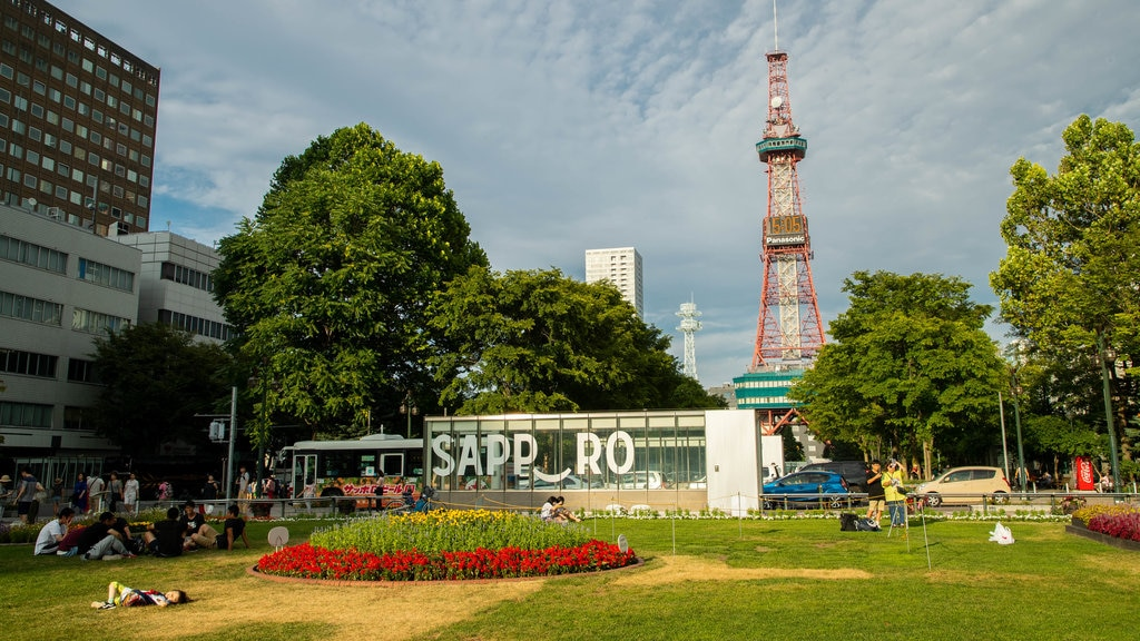 Odori Park which includes a garden, modern architecture and flowers