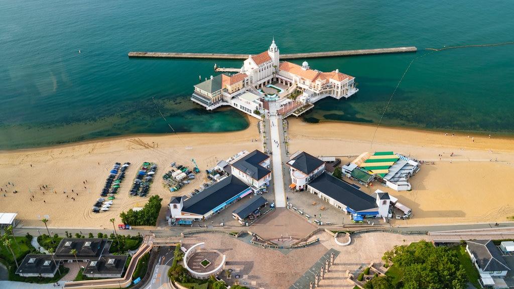 Fukuoka Tower featuring a sandy beach, general coastal views and a hotel