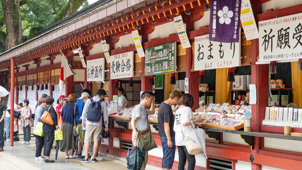 Dazaifu Tenmangu which includes markets as well as a small group of people
