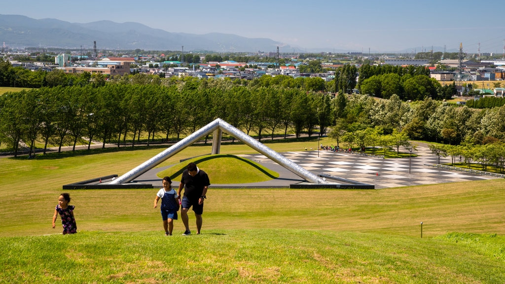 Moerenuma Park which includes a garden and landscape views as well as a family