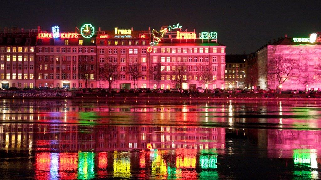 Copenhagen which includes night scenes and a city