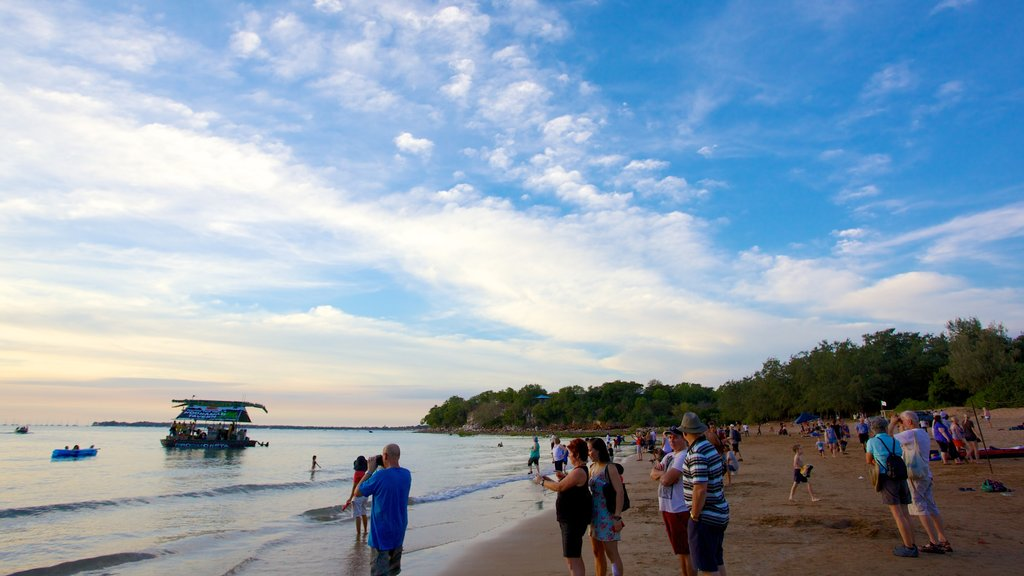 Northern Territory which includes a sandy beach as well as a large group of people