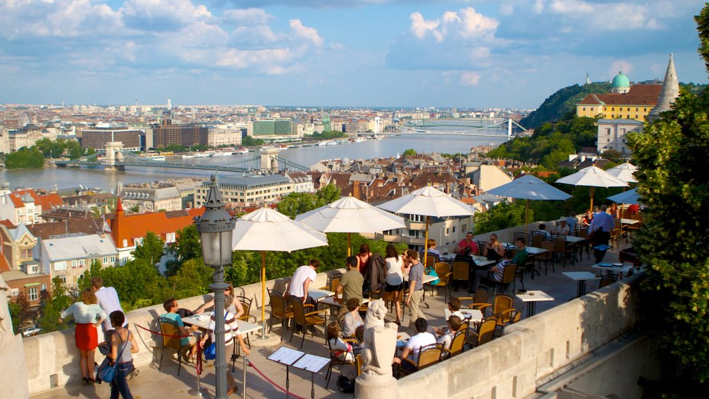 Buda Castle which includes outdoor eating and a city as well as a large group of people
