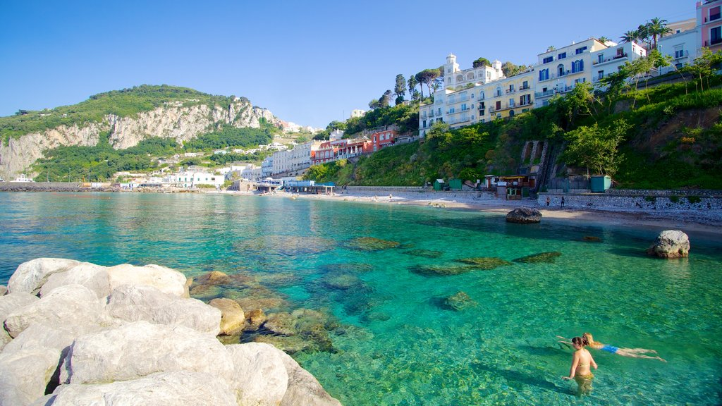 Capri showing a coastal town, rugged coastline and swimming