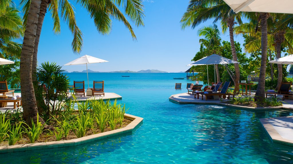 Fiji showing a coastal town, a luxury hotel or resort and general coastal views
