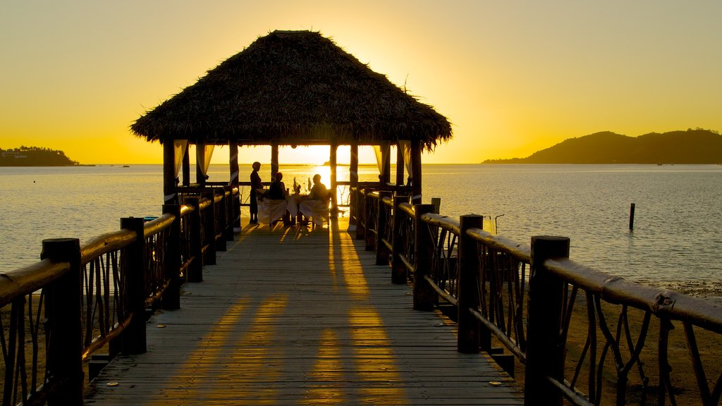 Fiji which includes general coastal views, outdoor eating and a sunset