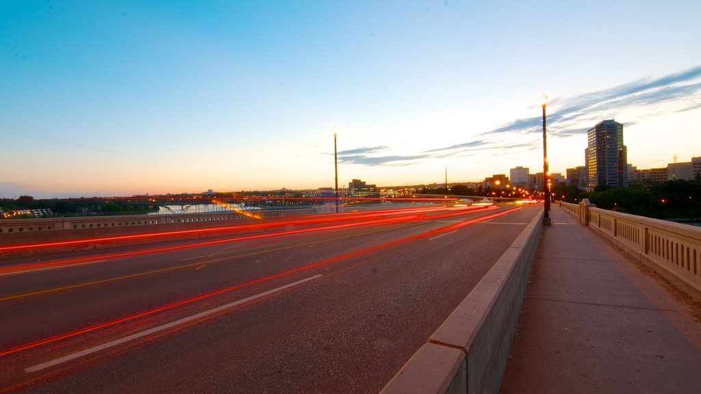 Saskatoon showing a sunset, street scenes and a city