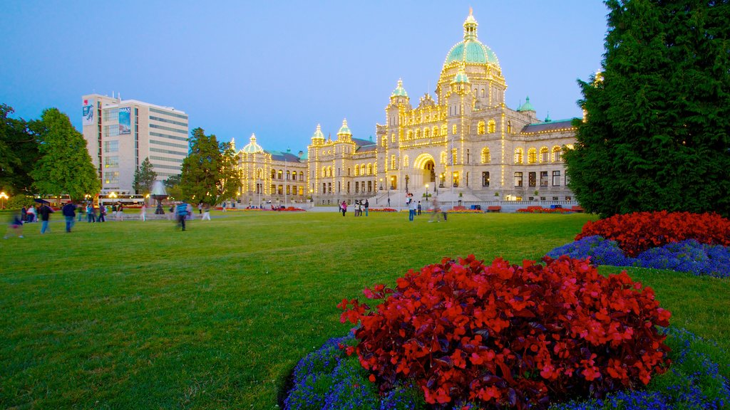 British Columbia Parliament Building showing flowers, an administrative buidling and a garden