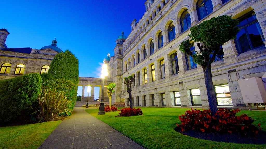 British Columbia Parliament Building showing a sunset, flowers and a garden