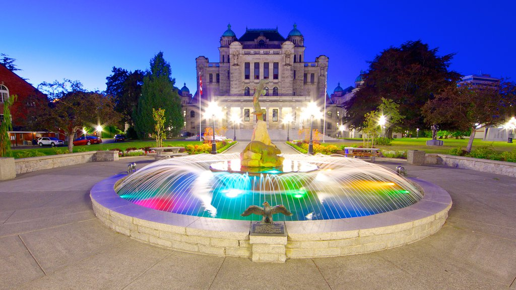 British Columbia Parliament Building featuring a square or plaza, a fountain and night scenes