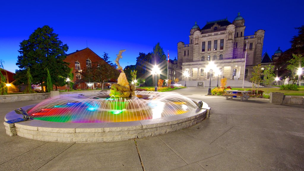 British Columbia Parliament Building which includes night scenes, a square or plaza and a fountain