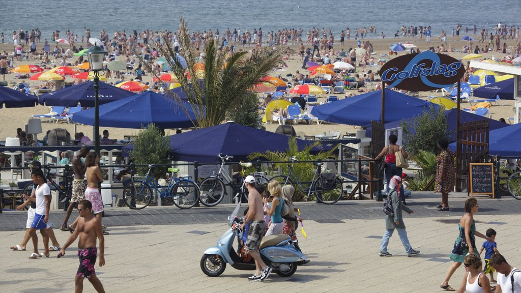 Scheveningen Beach featuring street scenes, a beach and motorcycle riding