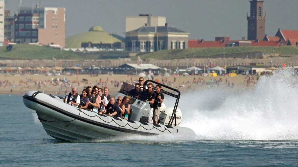 Scheveningen Beach showing boating and general coastal views as well as a small group of people