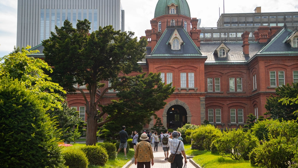 Former Hokkaido Government Office Building featuring heritage architecture and a park as well as a couple