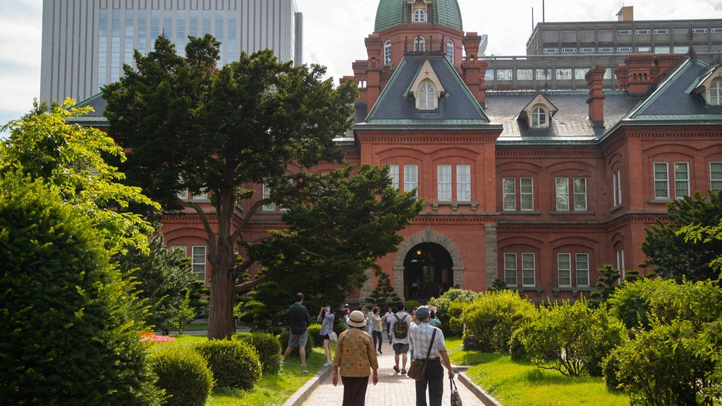 Former Hokkaido Government Office Building showing a garden and heritage architecture as well as a couple