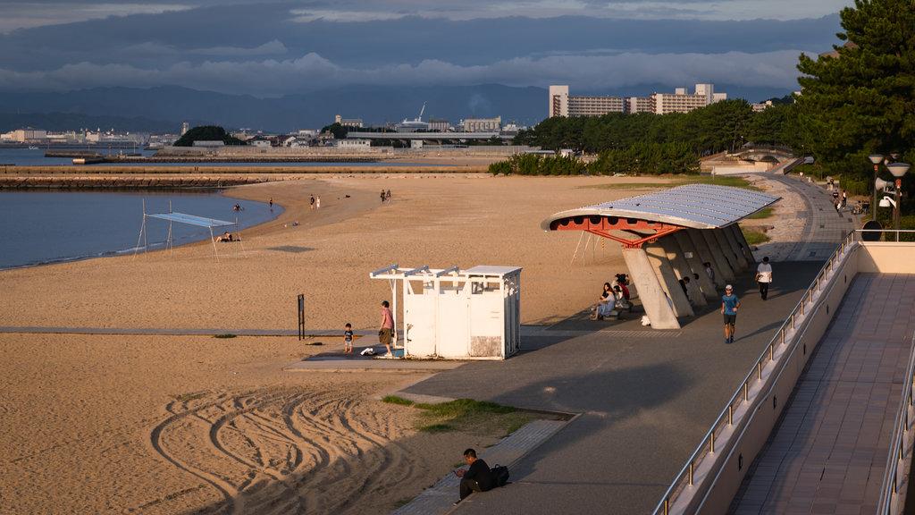 Momochi Beach which includes general coastal views, a sandy beach and a coastal town