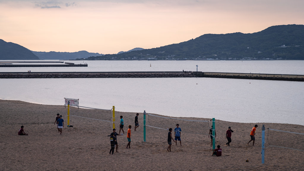Momochi Beach showing a sunset, a sandy beach and general coastal views