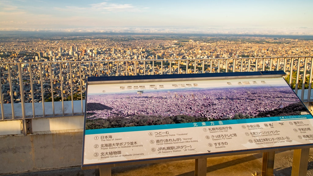 Mount Moiwa featuring signage, a sunset and views