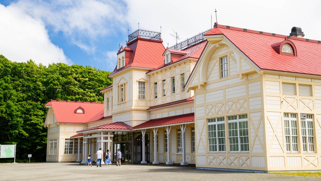 Historical Village of Hokkaido featuring heritage architecture as well as a family