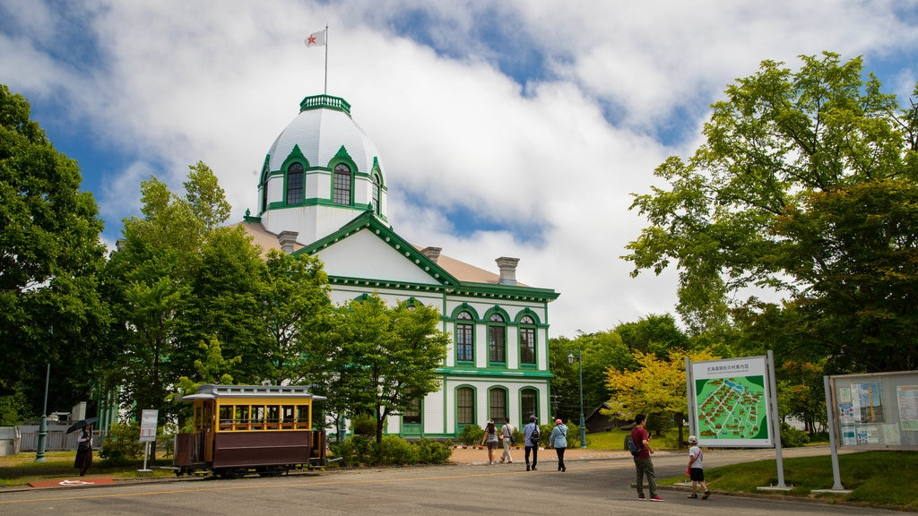 Historical Village of Hokkaido featuring heritage architecture and signage as well as a family