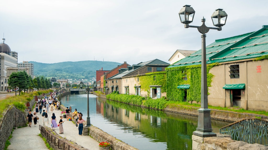 Otaru Canal showing a river or creek as well as a large group of people