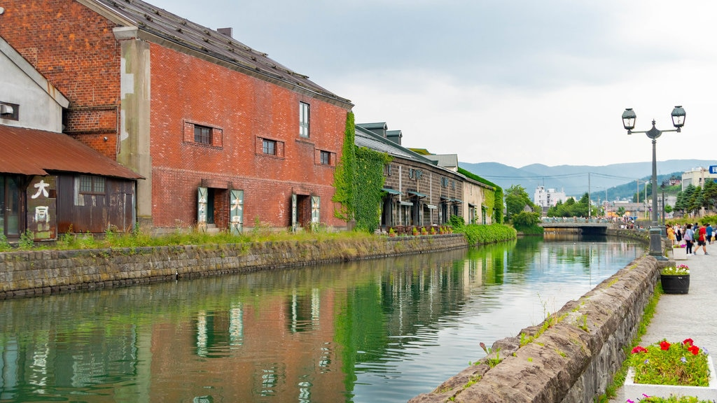 Otaru Canal which includes a river or creek and flowers