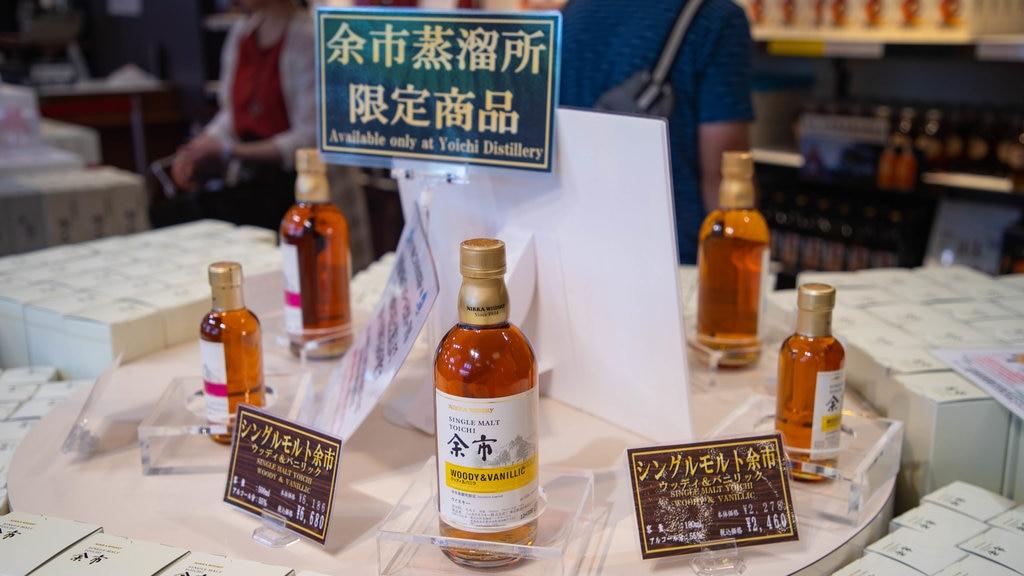 Nikka Whiskey Distillery Yoichi featuring signage, shopping and interior views