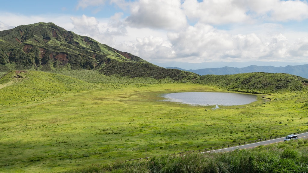 Mount Aso showing mountains, a pond and tranquil scenes