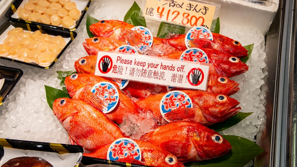 Sapporo Crab Market which includes signage, markets and food
