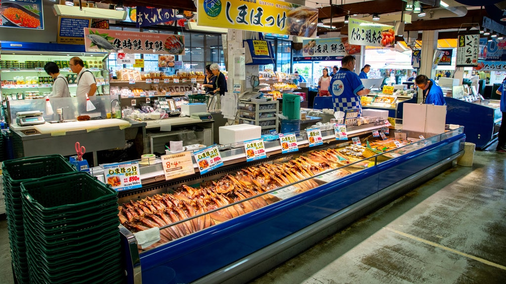 Sapporo Crab Market which includes markets, food and signage