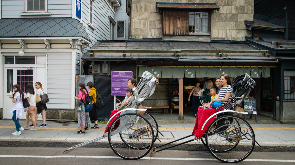 Sakaimachi Street which includes street scenes as well as a family