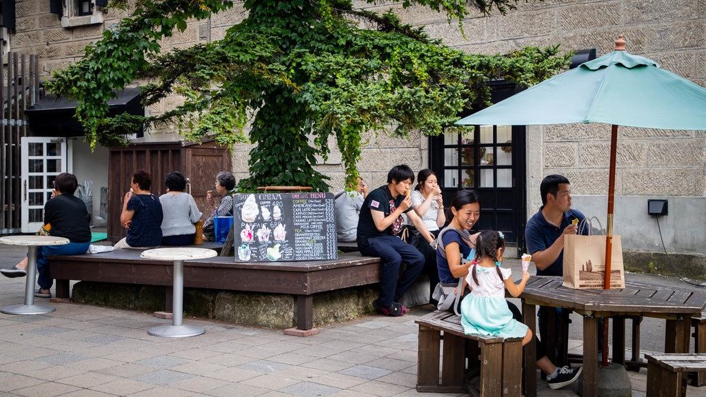 Sakaimachi Street showing street scenes and outdoor eating as well as a family