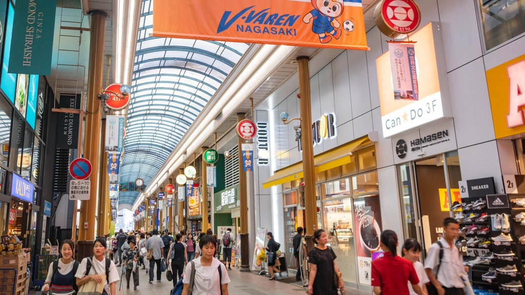 Hamanomachi Arcade showing interior views and shopping as well as a large group of people