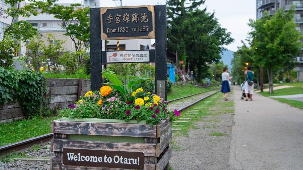 Otaru featuring signage, flowers and a garden