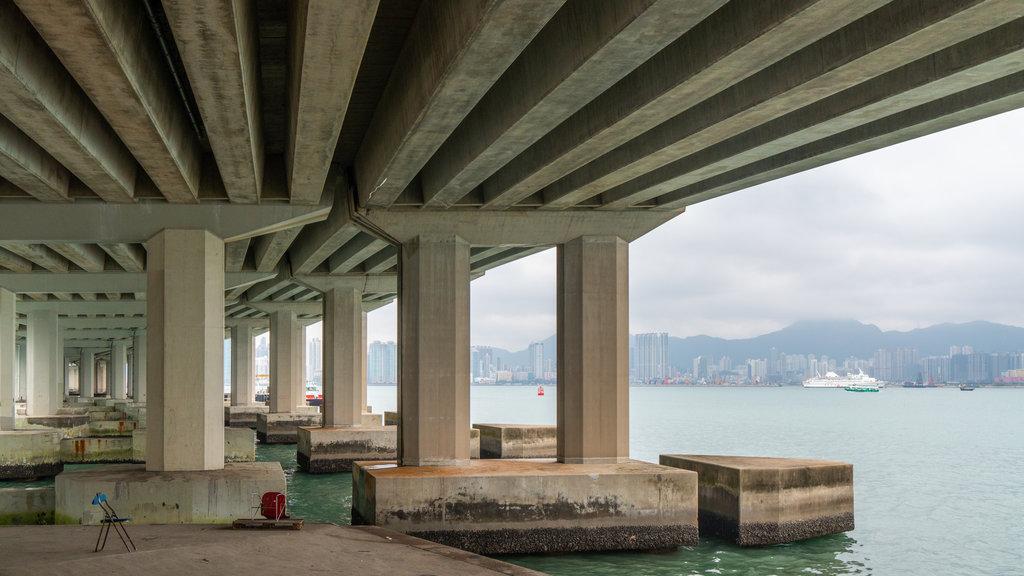 Tai Koo Shing featuring a bridge and a river or creek