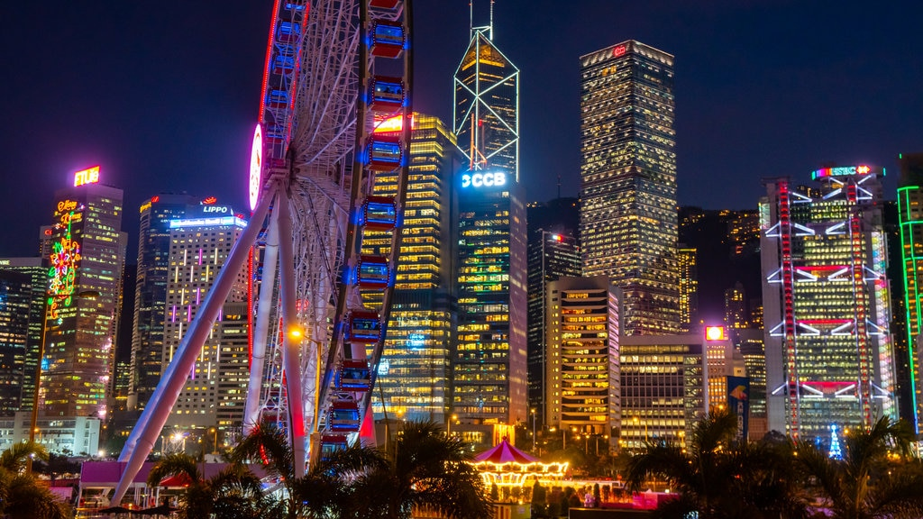 The Hong Kong Observation Wheel which includes night scenes and a city